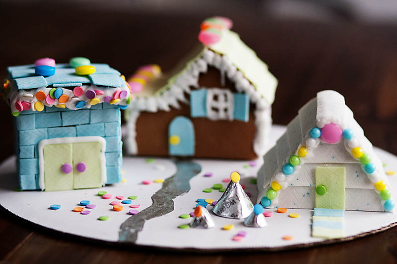 Gingerbread houses made with gum siding and accents. Such a fun idea and it looks pretty easy too!