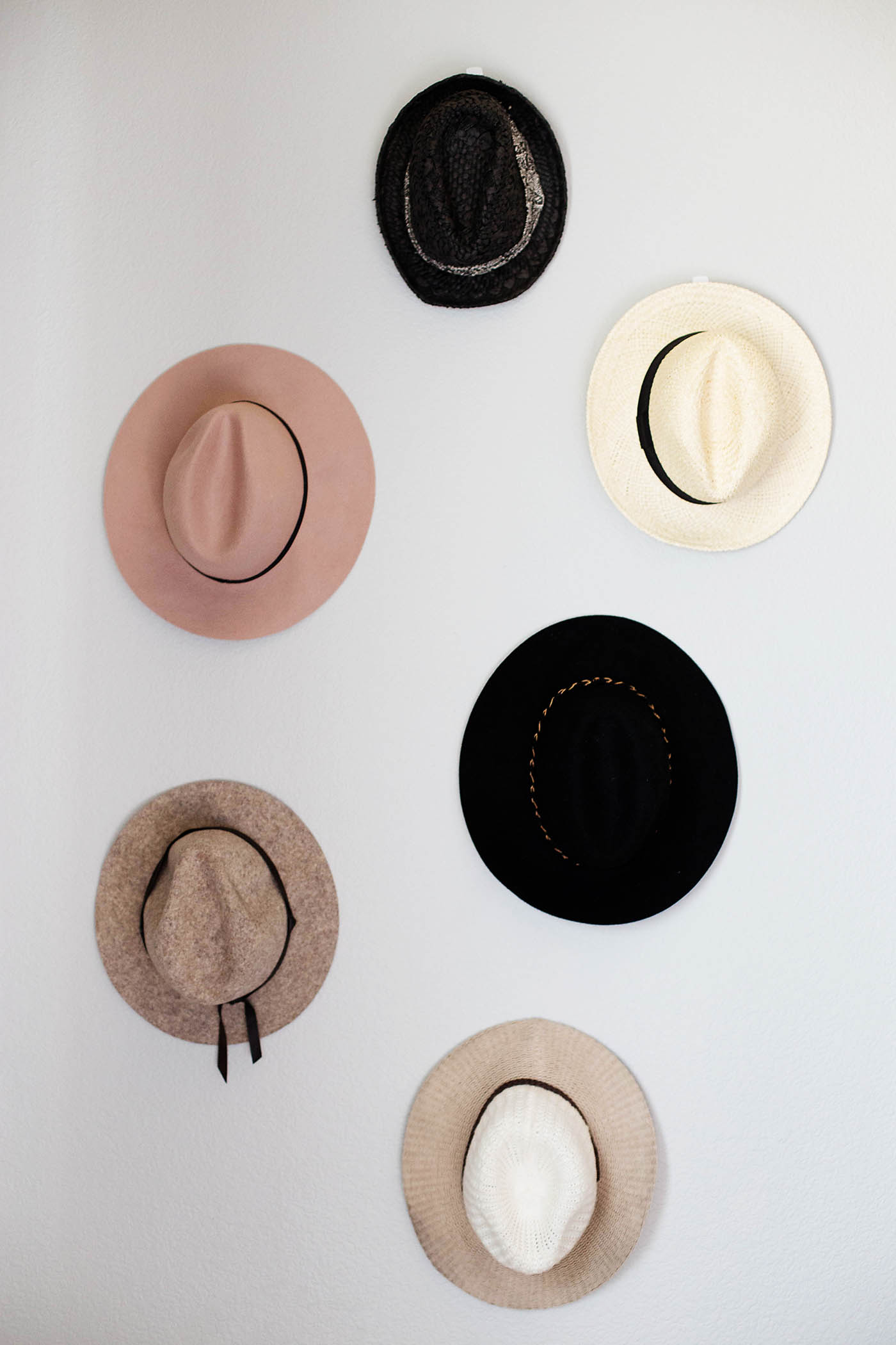 Easy DIY hat wall for the bedroom or living room. Such a simple way to store and display your hat collection!