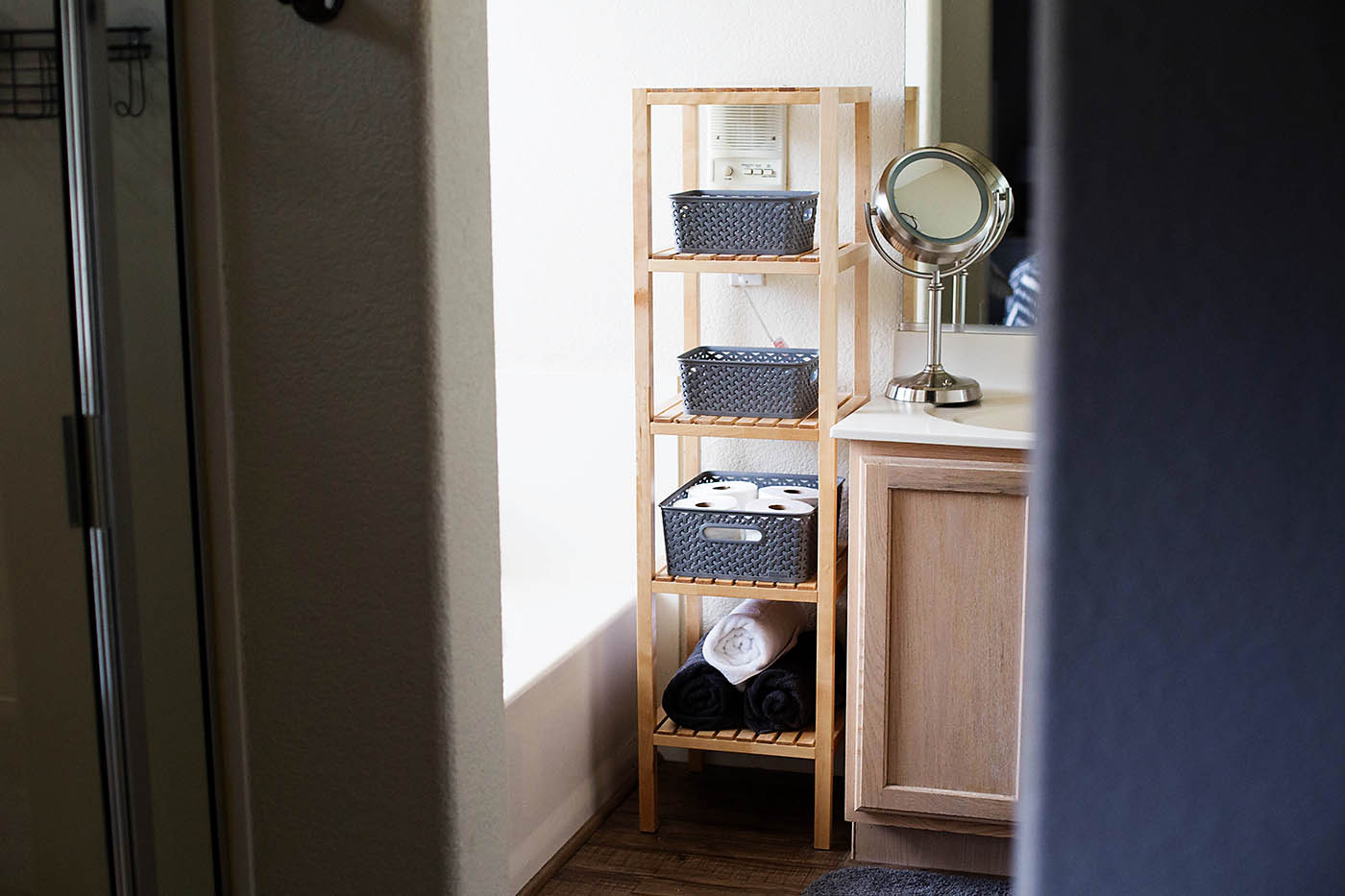 Open shelving bathroom organization tips